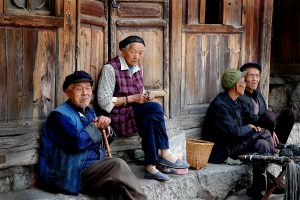 old chinese men and women socializing on the street